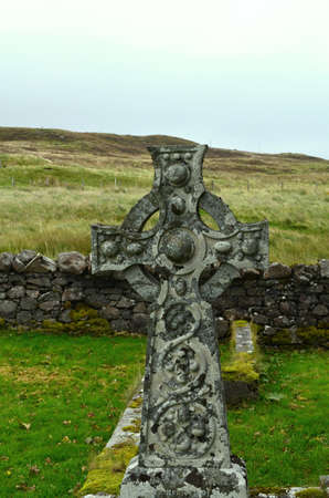 Dunvegans cemetery with a celtic cross in Scotland. 写真素材