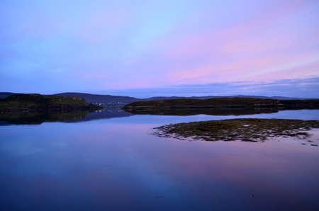 Serene loch dunvegan at twilight in Scotland.