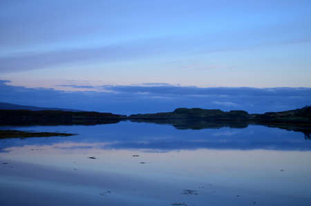 Reflections on Loch Dunvegan in Scotland.