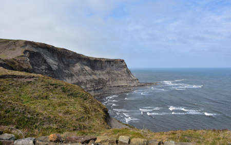 Stunning eroding stone sea cliff over Robin Hood's Bay in the UK.