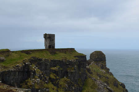 Ancient tower ruins in Ireland on the seacliffs.