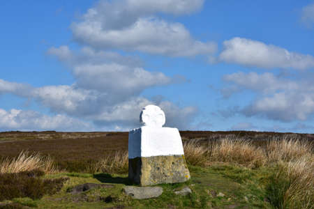 Large fat betty whitewashed stone memorial on the moors. Stock Photo