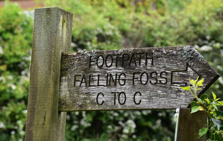Wood trail marker for footpath along the coast to coast route.