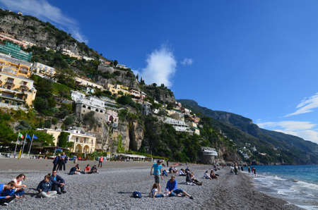 Rocky beach a the base of the village of Positano in Italy.