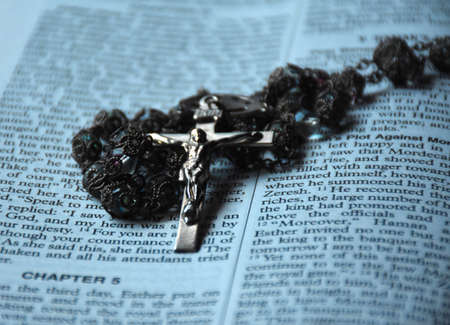 Rosary beads with a crucifix on the bible.