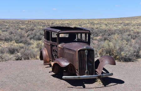Landscape with a  rusted antique Studebaker in Arizona.