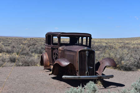 Classic rusty antique car found on Route 66 in Arizona.