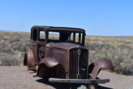 Unique rusted out antique car in Arizona.