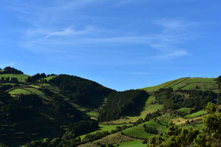 Blue skies with amazing green meadows and fields on a picture perfect day.