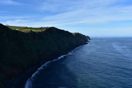 Green fields on top of the sea cliffs in Sao Miguel.
