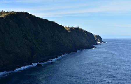 Tall green sea cliffs along the coastline of  Sao Miguel.