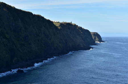 Sao Miguel's coastal sea cliffs with rolling waves.