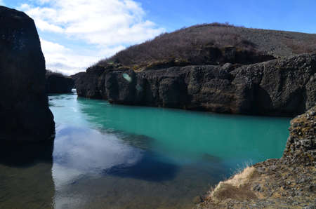Stunning river flowing through large rock formations 写真素材