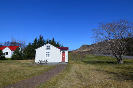 Cute red roofed Icelandic houses in a scenic landscape  写真素材