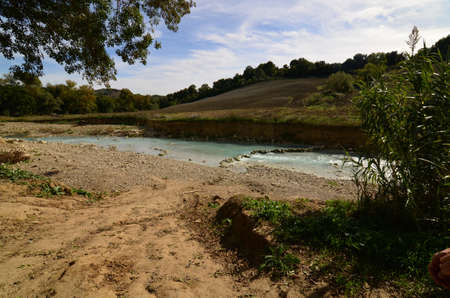 Flowing river at Saturnia's thermal baths in Tuscany Italy.