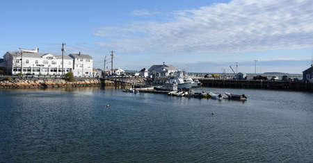 Scenic panoramic view of Plymouth Harbor with boats docked.