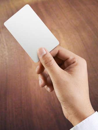 man holding card: Hand man holding card