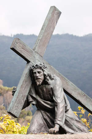 Bronze sculpture of Jesus carrying the cross, Monserrate  Bogota, Colombia  photo