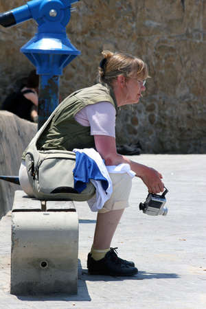 Paphos, Cyprus - Mai 25, 2009: The tired Tourist did a midday pause in the Port of Paphos.
