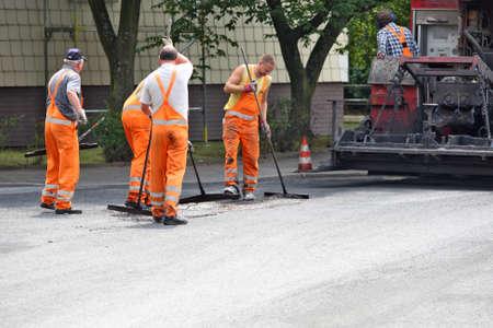 Dusseldorf, Germany - 30  July 2010  Workers laid asphalt on a street in Dusseldorf