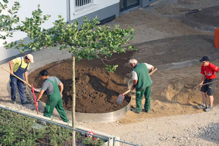 Dusseldorf, Germany - 16  July 2013  Workers carry out landscaping on one of the new settlements in Dusseldorf Редакционное