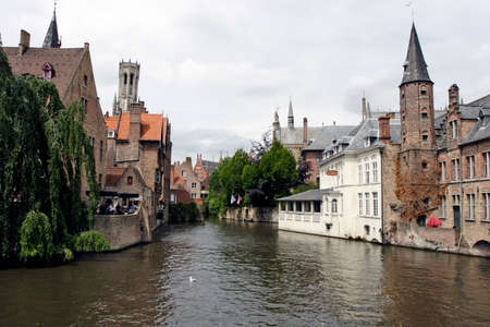 Historic part of the city lies on the canal in Brugge (Belgium) - May 28, 2011