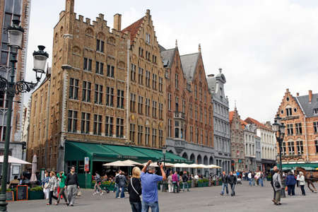A lot of historical buildings you can see on the Market Square in Brugge (Belgium) - May 28, 2011