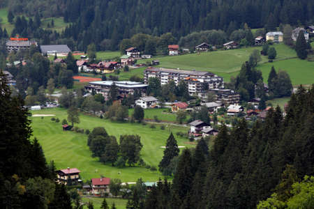 Valley views of the golf course and Adjacent-hotel complex in Bad Gastein (Austria) - September 15, 2011 Редакционное