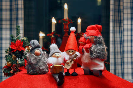 Composition of seasonel Christmas Figurines with symbol background