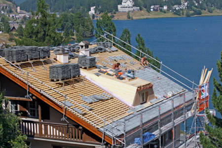 SANKT MORITZ, SWITZERLAND - JULY 16: In the summer months there is a reconstruction of roofing in Sankt Moritz, Switzerland on July 16, 2015