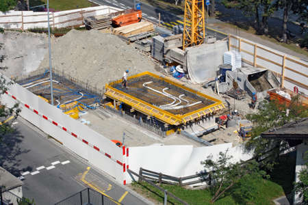SANKT MORITZ, SWITZERLAND - JULY 16: Preparing the foundation for the construction of a new building in Sankt Moritz, Switzerland on July 16, 2015