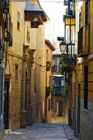 TOLEDO, SPAIN - APRIL 5: Typically narrow streets in the historic city of Toled, Spain on April 5, 2010