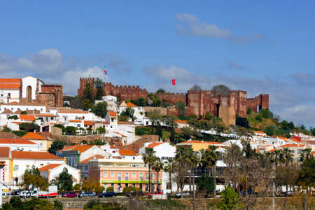 SILVES, PORTUGAL - MARCH 13: The Panorama features the skyline of the old part of Islamic fortress from the 8th century and it is in the list of national monuments of Silves,Portugal on March 13, 2015 Редакционное