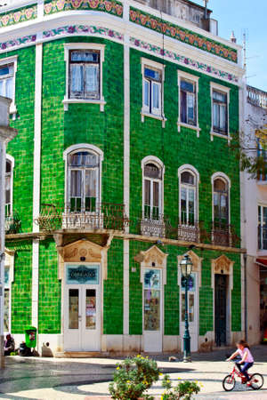 LAGOS, PORTUGAL - MARCH 28: Resulting in the nineteenth century last variant is disguising whole facades.The ceramic tiles are water resistant, dont need maintenance Lagos, Portugal on March 28, 2015