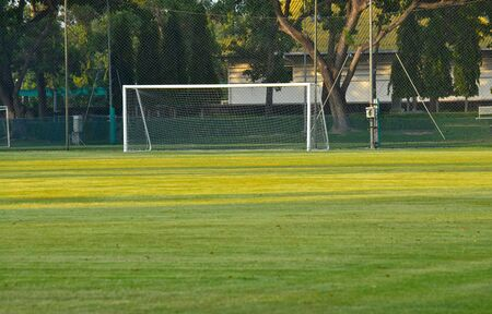football field Is a green lawn That has been beautifully trimmed