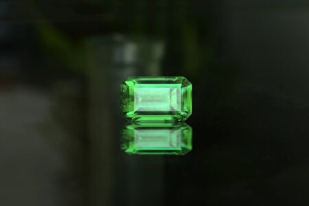 Emerald green On the glass floor and reflections