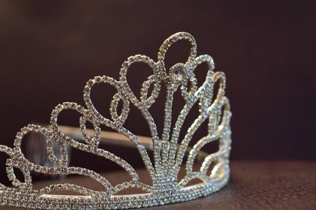 Crown set with diamonds On a beautiful leather floor Reklamní fotografie