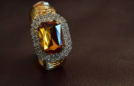 Decorated with yellow gemstones Surrounded by diamonds
