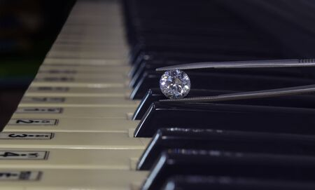 Selected diamonds are clear, clean, rare, expensive, on a beautiful, elegant piano background.