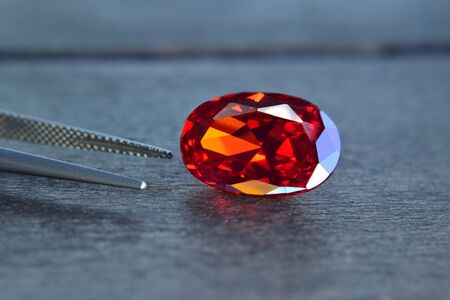 ruby Is a beautiful red gemstone on a wooden floor