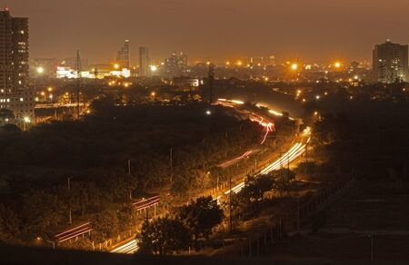 view of a busy road at night time