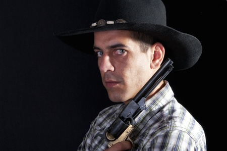 cynical: cowboy with hat and revolver