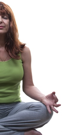 redhead woman practicing yoga isolated photo