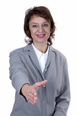 beautiful businesswoman offering hand with a smile photo