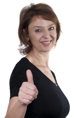 beautiful brunette mature woman giving thumbs up with white background photo