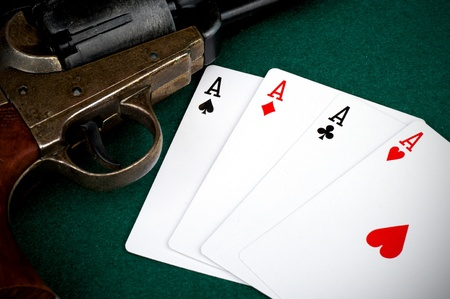 four aces on table and old colt Stock Photo - 10411868