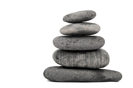 stack of balanced zen stones isolated on white background  photo