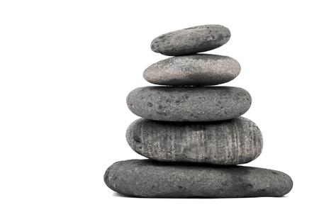 steadiness: stack of balanced zen stones isolated on white background  Stock Photo