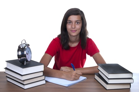 studing: teenage girl studying on her desk with a white background