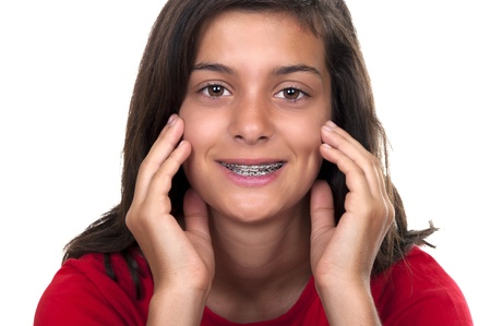 Isolated pretty teenage girl with braces smiling Stock Photo - 10411834